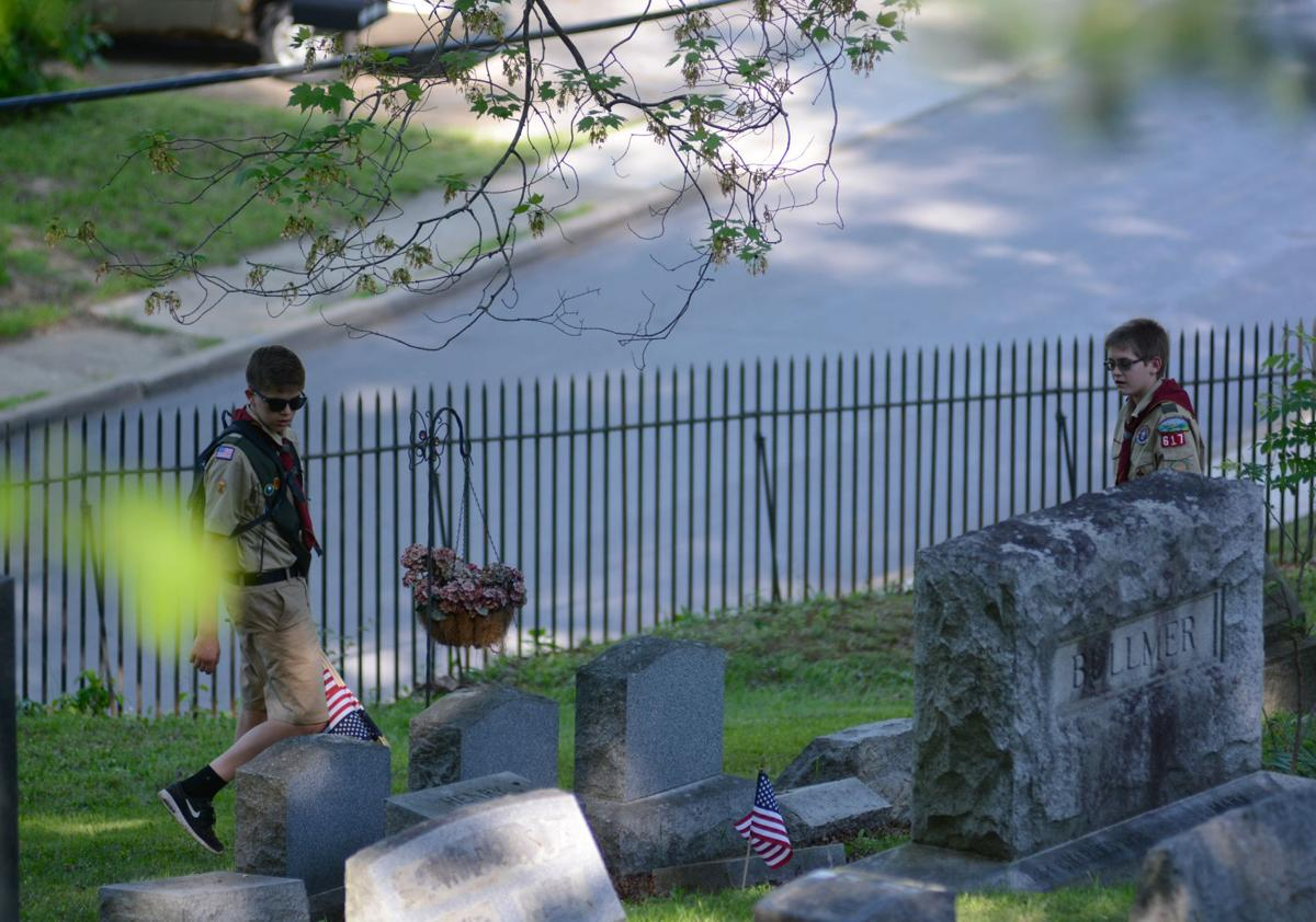 Boy Scouts of Troop 617 search the graves at Mount View Cemetery