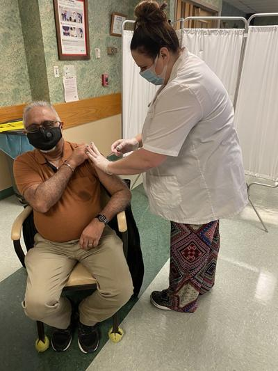 Nursing home residents, some staff now getting COVID-19 vaccine