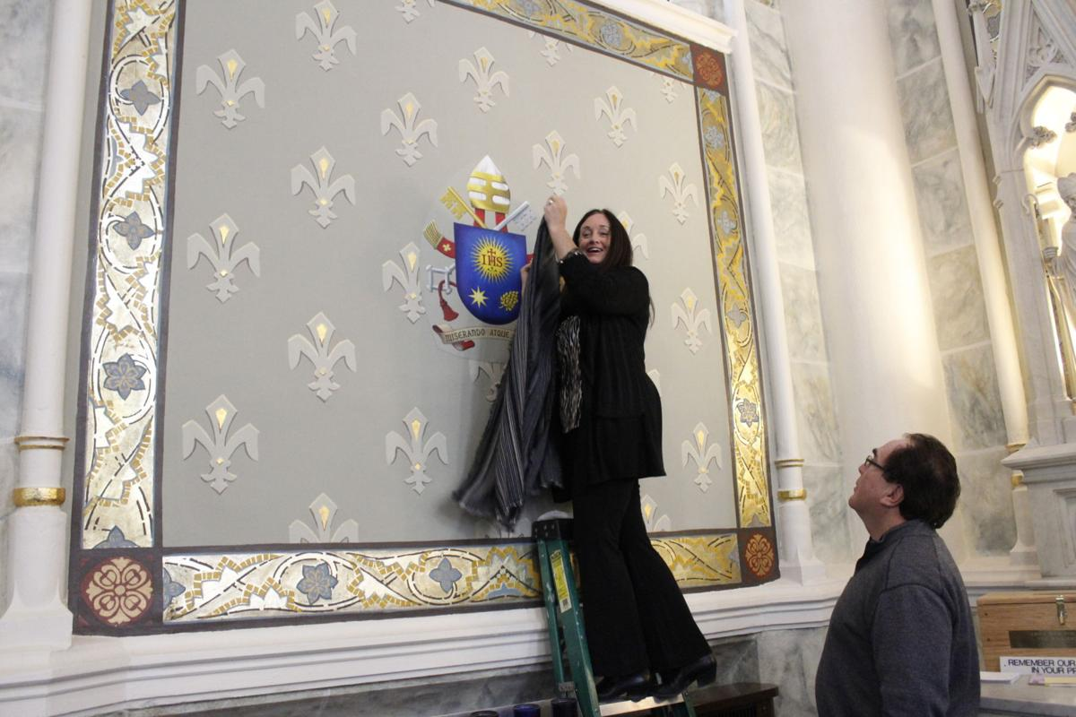 unveils Pope Francis' coat of arms