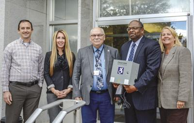 Local leaders accept four mobility charging stations on Thursday from the Cattaraugus County Healthy Livable Communities Consortium