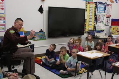 Trooper Sean Needham reads to Onida kindergartners