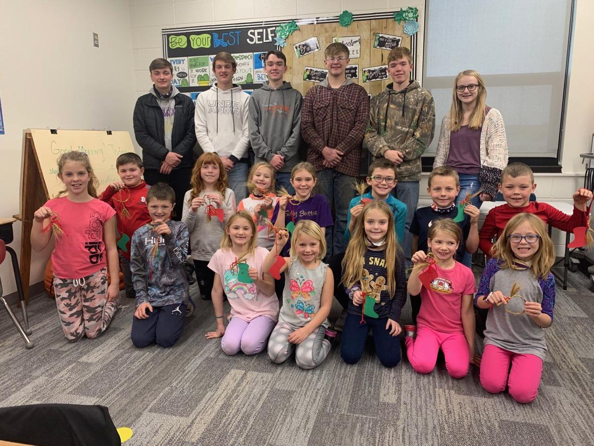 Sully Buttes upperclassmen lent a hand in helping the second graders weave wheat.