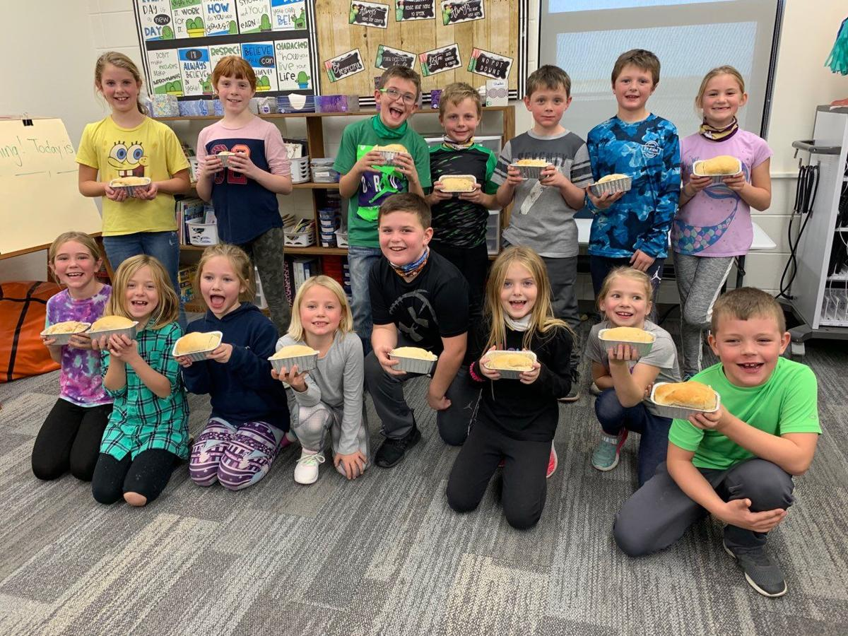 The second graders posing with their newly baked bread.