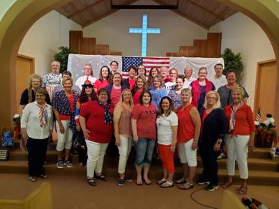 The members of the Sully Area Singers led the audience in singing  patriotic favorites during the Red, White and Tunes songfest on June 15. Back - Rolly Kemink, Dave Strable, Susan Lamb, Griffin Petersen, Lynn Senftner, Cordell Ring, Sherise Wittler, Mark McQuirk, Julene Yackley, Chuck Todd, and Jeff Adel. Middle - Choir Director Marla Mosiman, Beth Rinehart behind Jackie Yackley, Diane Lorenz, Jolene Schall, Amy Petersen-Kolb, Colette Kemink, Katie Shepherd, Laura Cook, and accompanist Judy Foth. Front - Sandii Bartell, Sheila Ring, Mary Sieck, Stacie Mosiman, Lynn Leonard, Nola LaRosh, Dar Hofer, and Lillian Campbell.