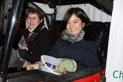 In the Ringneck Energy parade entry, Janet Wendland and Mariko Ogawa of Tokyo, Japan, tossed candy to the children along the 'Twas the Night Before Christmas parade route.