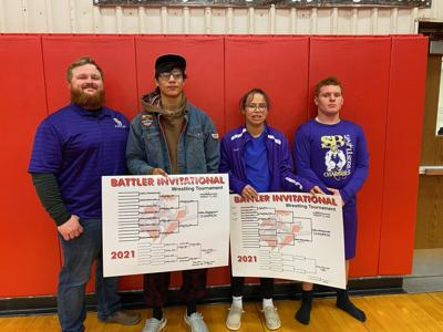 Chargers Wrestling Coach Brady Weischedel, Chase Yellowhawk, Cateri Yellowhawk, and Kash Weischedel.