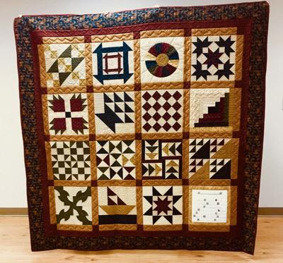 """Underground Railroad"" sampler quilt made for raffle."