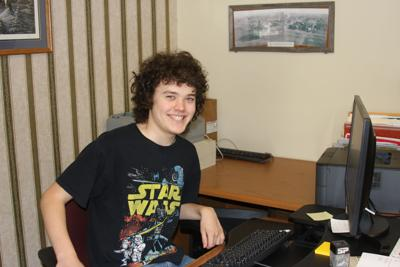 Onida Watchman student intern Justin Davey is pictured at his desk.