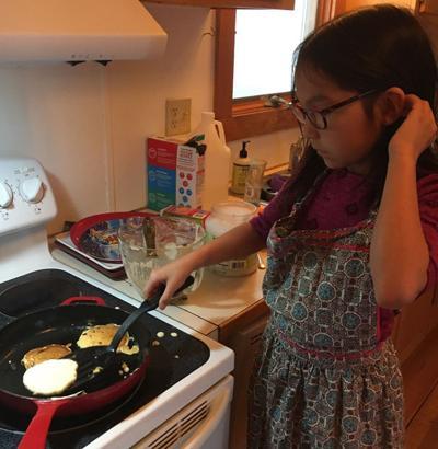 Harmony Cook making pancakes.
