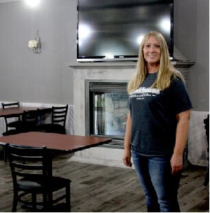 Laynee Brandt in the Bunkhouse's newly renovated dining room.