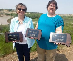 Editor Marileen Tilberg and Reporter Sheila Ring display the first place plaques they won at the South Dakota Newspaper Association Conference Friday.