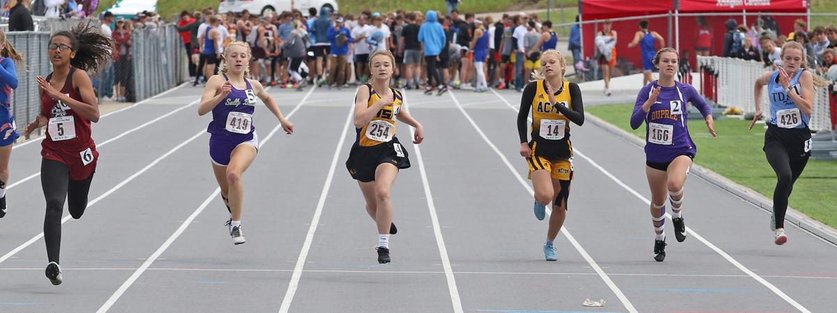 Stevie Wittler runs hard in the hurdles to place at State.