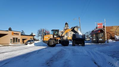 With the larger bucket on the city's new payloader, city crews made quick work of clearing the windrow of snow from Main Street.
