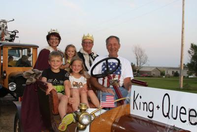 RIDE WITH ROYAL GRANDPARENTS. By a consensus of the community, Janice and Rodney Haag were selected to reign over the 2019 Blunt Fest. They were accompanied in leading the Parade of Lights by their grandchildren Archie and Tillie Haag in front and Presley Baloun in back between the monarchs. They were chauffeured in style by Neil Spaid in his vintage vehicle.