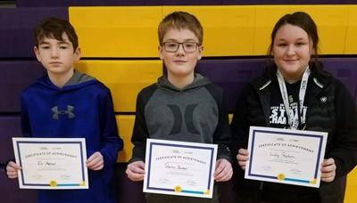 3rd place Eli Mercer, 2nd Gavin Barber, and 1st Lilly Paxton.