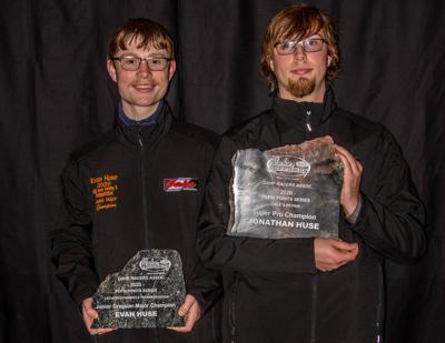 Evan Huse  and Jonathan Huse holding their awards
