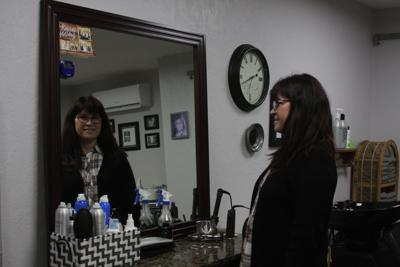 Diane Lorenz's smiling face looks out from her mirror, a view familiar to Diane's  salon clients.