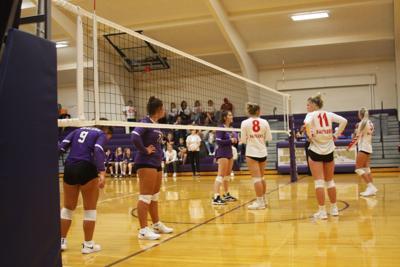 Calleigh Chicoine, Addison Chicoine and Trichelle White prepare to receive the serve.