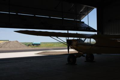 The view from inside of one of the hangars the city recently invested in building, as the automatic hangar door is being opened.