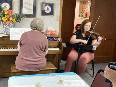 Marla Mosiman and Moriah Gross played soothing melodies as the babies were rocked.