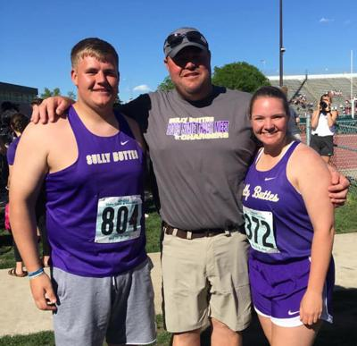 State champion shot put throwers, Jett Lamb and Lauren Wittler flank Sully Buttes throwing coach Tom Moore.