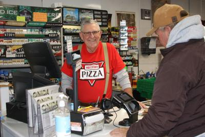 Don Waggoner behind the cash register at The Corner