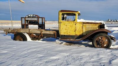 The old truck near the driveway of Mark and Shirley Barber's farm is an interesting contrast to the modern equipment used for snow removal throughout Sully County.