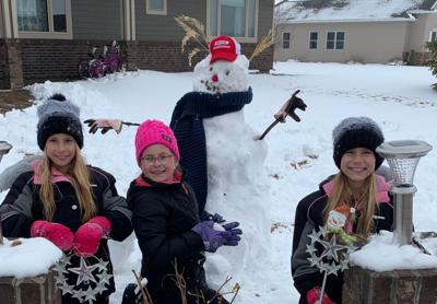 Justice Sovell, cousin Taytum Voorhees, and Josie Sovell pose with their snow creation. Justice and Josie challenged the community on Monday to build snowmen, pledging $10 to the Sully County courthouse dome restoration project for every snowman built.
