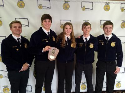 Jack Darling, Rafe Wientjes (holding plaque), Landon Severson, Lydia Hill and Blaine Hill