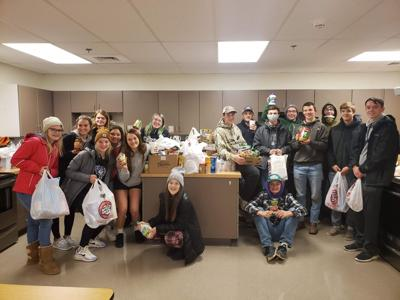 Seventeen students took part in gathering food, and ended up with several bags and boxes filled with canned goods, packaged foods, cereal, etc. After all of the donated goods were delivered, they were all stacked at the back of Vicki Lentz's classroom kitchen area, which filled approximately one-half of the area with the overabundance of food items.