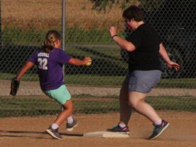 Karmen Merrill races Maghan Hiller Merrill to third base