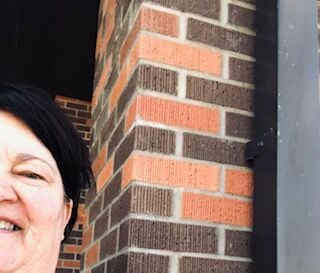 To introduce the game, Lynn Senftner posted this selfie in which she is partially visible, taken at the north entrance of the school. The next day, her thumb was included in the picture of the monument at the city pool that kicked off the game, but for the remainder of the contest, Lynn was decidedly absent from the photographs.