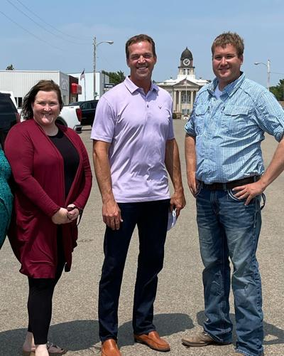 Flanking First Gentleman Bryon Noem are Onida Mayor LaJena Gruis and Fire Chief Caleb Shepherd during their tour of the community last Friday.