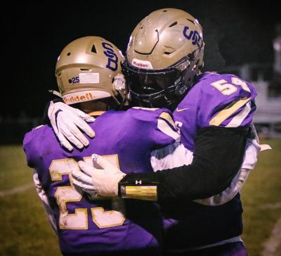 Seniors Grant Johnson and Jett Lamb #54 console each other after their only loss during a home game in their four-year high school career.They lost a total of five games in the past four years.