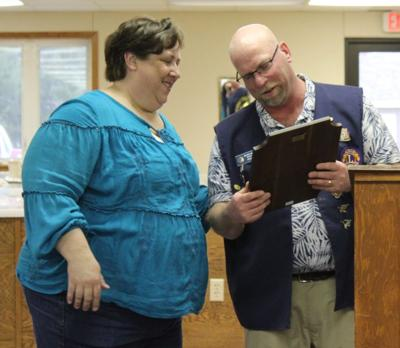 Lion Brian Ring shows his wife Sheila the plaque he received.