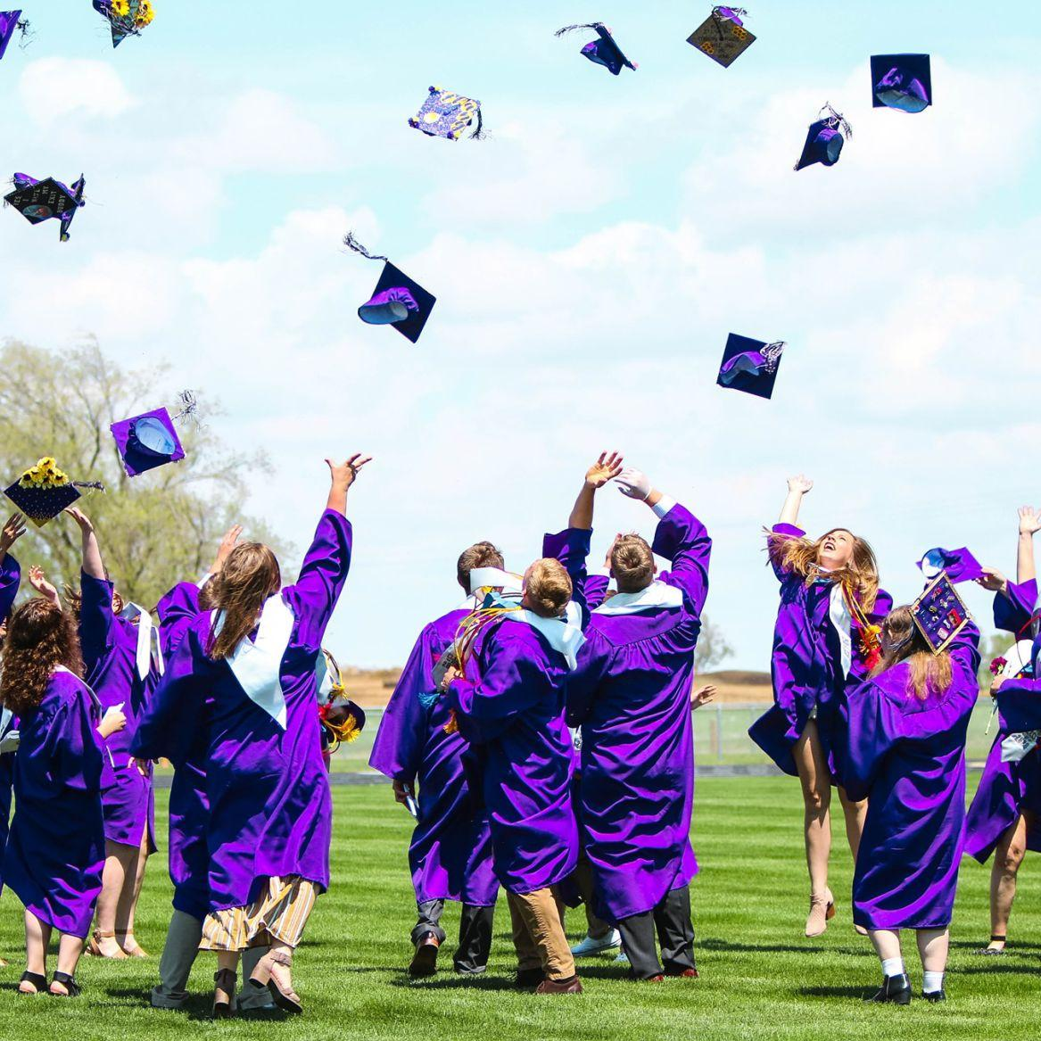 Graduates tossed their hats high