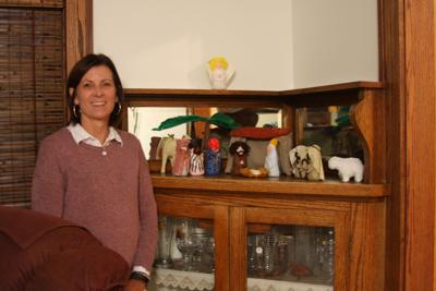 At Christmastime, the homemade nativity that started her collection  is displayed on the corner hutch in Becky Lamb's dining room.