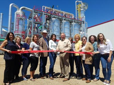 Posing with members of the Onida Chamber of Commerce, Walt Wendland, Ringneck Energy Chief Executive Officer, cut the ribbon during a brief ceremony. Pictured are Cheri Wittler,Brenda Currier, Kim Wickum, Kelli Stephens, Lt. Governor Larry Rhoden Governor Kristi Noem, Wendland, Leann Weischedel, Trish Severson, Marileen Tilberg, Sarah Ramler and Hannah Warner.