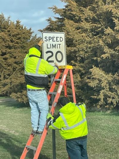 Sully County Highway Department crew members erected signs for new speed limit and dynamic braking ordinances.