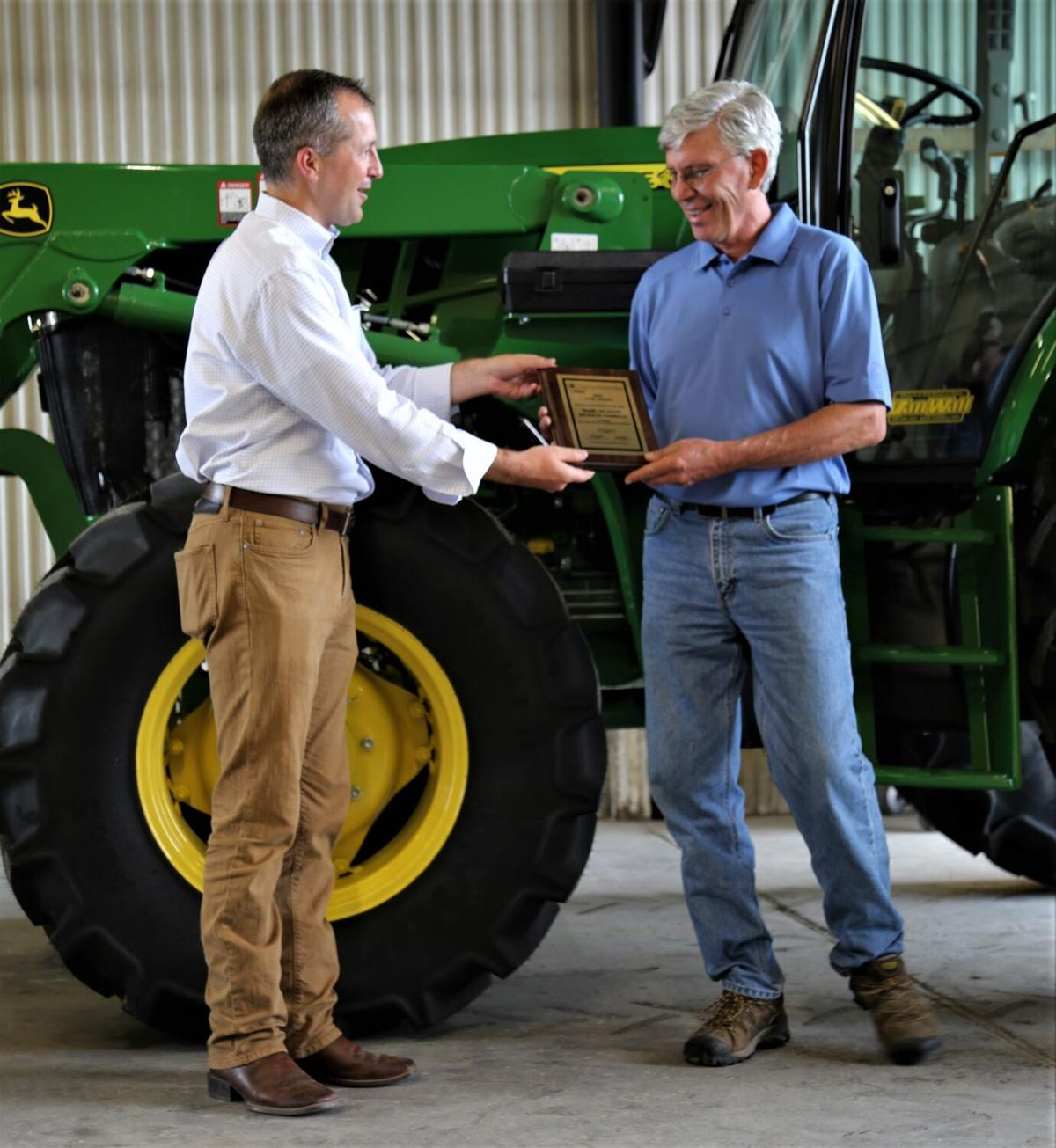 Mark Jackson and Iowa Secretary of Agriculture Mike Naig