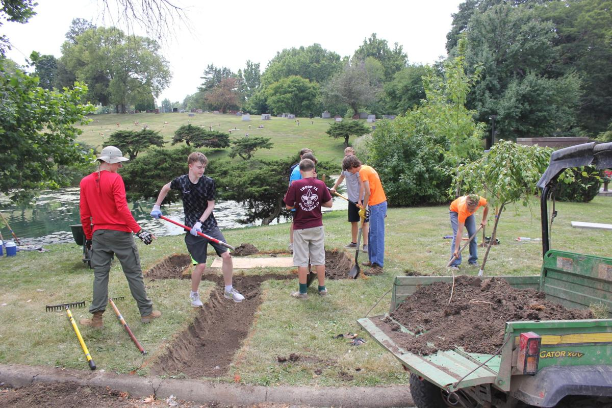 Members of Troop 71 work on first responders monument