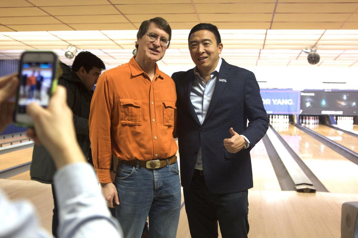 Oskaloosa resident Richard Sawyer poses with 2020 Democratic presidential candidate Andrew Yang for an 'usie.'