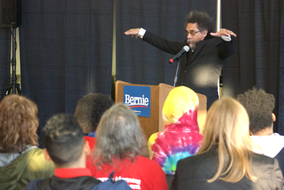 Political activist Dr. Cornel West speaking to event goers at a Bernie Sanders' Town Hall on Tuesday.