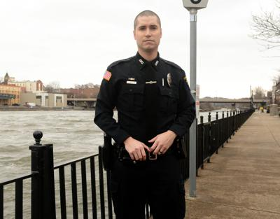 Hero cop who rescued woman: 'Just doing my job'