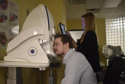 Drs. Forde and Davis using Optos Machine