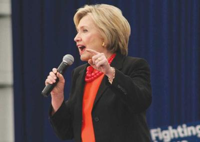 Clinton says she'll fight for equal pay, debt-free college