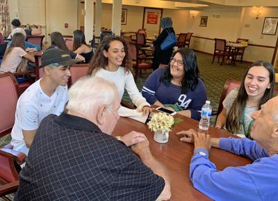 SUNY Oswego Summer Intensive English Program students have much to talk about with residents at Bishop's Commons