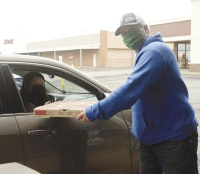 GJP hands out pizzas to Oswego seniors