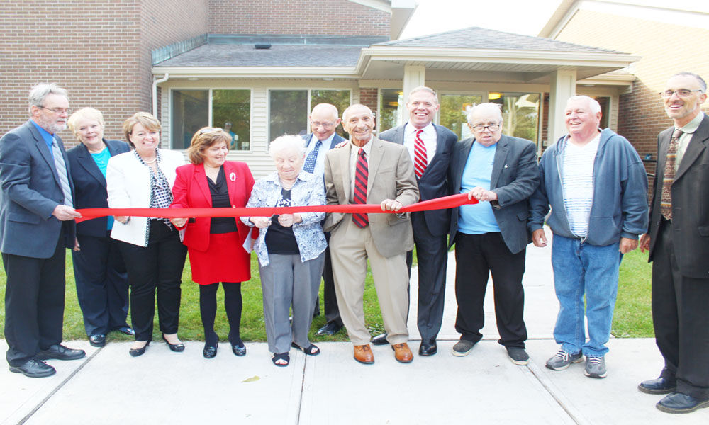 Fulton's Emery Grove Apartments celebrates with ribbon cutting