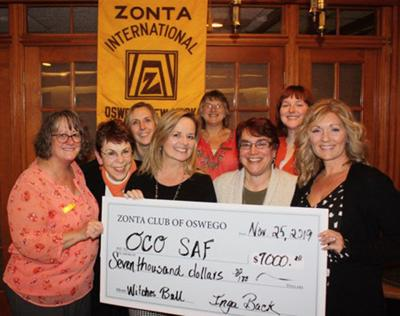 Oswego Zonta casts out violence against women